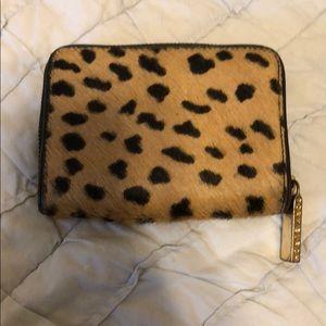 5761fc8a3298 Tory Burch Bags - Tory Burch cheetah print wallet